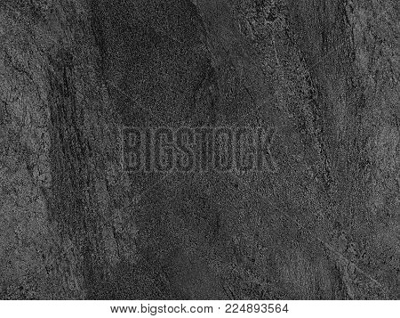 Natural black volcanic seamless stone texture venetian plaster background. Dark volcanic rock venetian plaster stone texture grain pattern. Black seamless grunge stone background texture rock surface. Burned wood texture