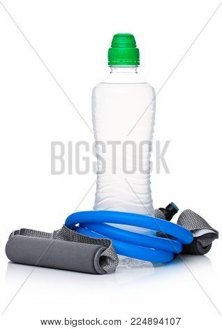 Bottle of hydro sport energy drink with resistance band on white background