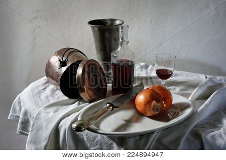 Still Life, Bottle Of Red Wine, Onions And Old Crockery