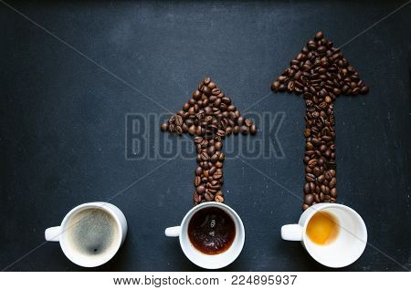 Coffee and arrow from coffee beans. Move up of energy. Trend up of energy. Arrow and graph. Coffee on a blackboard. Concept of energy