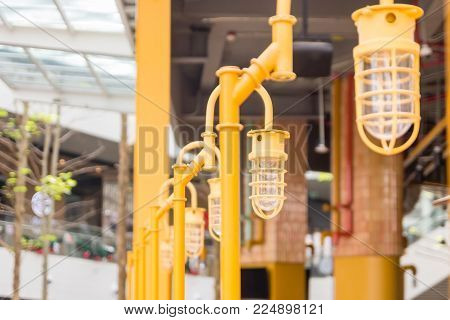 Street lamp pole design with blurred background. Outdoor light pole