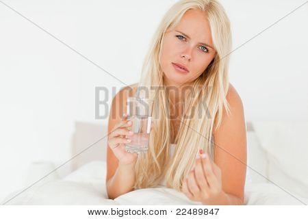 Blonde Woman Taking A Pill