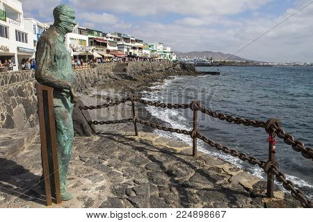 Lanzarote, Spain - January 20th 2018: A Sculpture Of A Man Looking Out To Sea, Located On The Promen