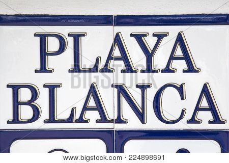 A Tiled Playa Blanca Sign.  Playa Blanca Is The Southernmost Town Of The Spanish Island Of Lanzarote