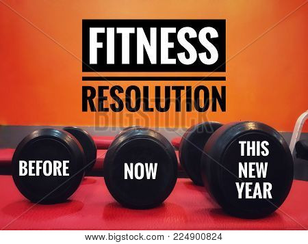 Fitness resolutions concept - Words Before, Now and This New Year written on dumbbells in a fitness gym. With vintage styled background.