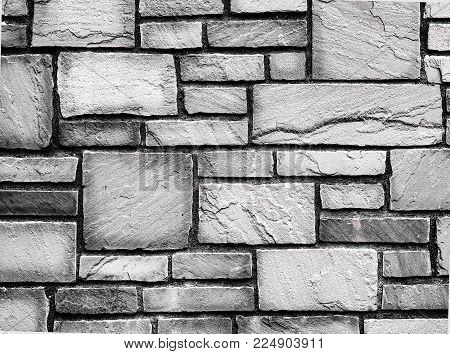 Black And White, Old Rough Textured Paved Brick Wall. Genuine Old Weathered, And Textured Rough Bric