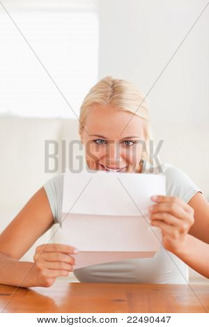 Smiling Woman Reading A Letter