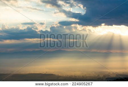 beautiful sunrise landscape with mist and sun lighting in morning
