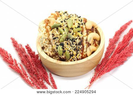Closeup of two Sweet Crispy Rice Cracker with several cereal on wood cup and dry grass