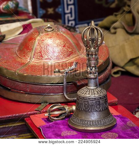 Buddhist religious equipment - Vajra Dorje and bell in tibetan monastery. Ladakh, Jammu Kashmir, India . Close up
