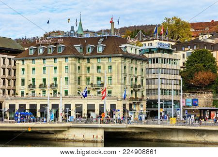 Zurich, Switzerland - 25 October, 2017: people and buildings on Central Square in the city of Zurich. Central Square is a town square at the northern end of Limmatquai quay, it is one of the city's nodal points for road and public transportation.