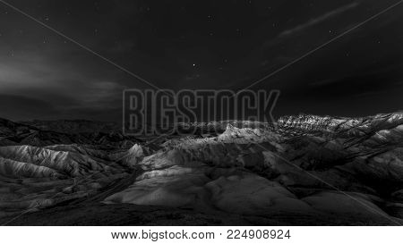 Early dawn light over Zabriskie Point and Manly Beacon in Death Valley, CA