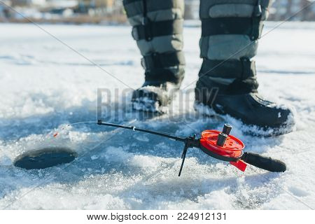 close up ice fishing tackles and equipment. winter holidays and people