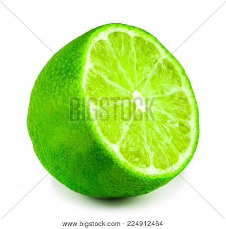Half of lime citrus fruit. Lime cut isolated on white background. Sliced lime half with clipping path.