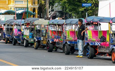 Bangkok, Thailand November 29, 2017: Bangkok, Thailand November 29, 2017: Thailand native taxi call tuk-tuk are waiting for passengers near grand palace or Wat Phra Kaew