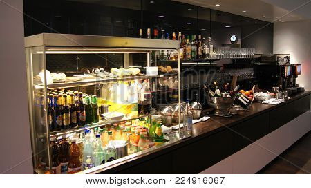 ZURICH, SWITZERLAND - MAR 31st, 2015: airport business class lounge interior of SWISS, buffet and eating area in a frequent flyer lounge for Gold customers, food and drinks.