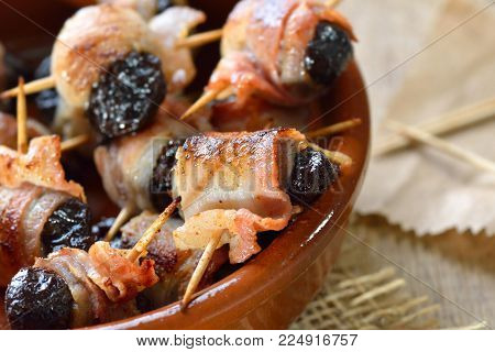 Delicious Spanish tapas:  Fried prunes wrapped in bacon