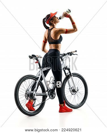 Girl cyclist with bicycle drinking a water  in silhouette on white background. Rear view. Sport and healthy lifestyle