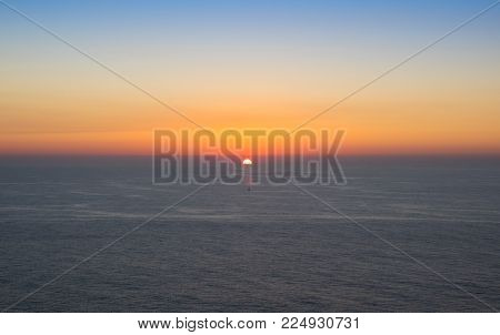 Sunset over Atlantic ocean. View from Cabo da Roca (Cape Roca), a cape which forms the westernmost extent of mainland Portugal and continental Europe