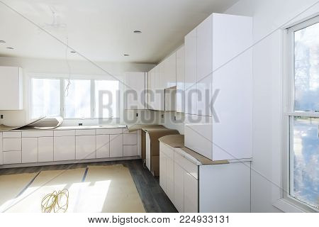 Installing new induction hob in modern kitchen Home Improvement Kitchen Remodel worm