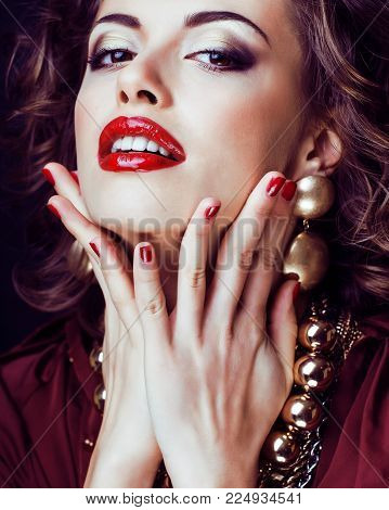beauty rich brunette woman with a lot of jewellery, hispanic curly lady poster