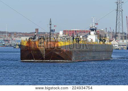 New Bedford, Massachusetts, USA - February 3, 2018: Tug Delaware pushing barge Double Skin 50 on Acushnet River