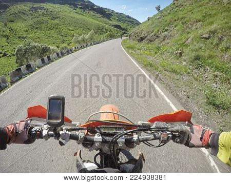 Journey extreme trip with dirtbike in the mountain adn blue sky