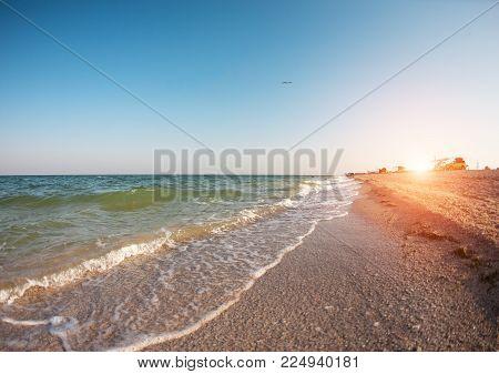 Sea Coast At Sunset.
