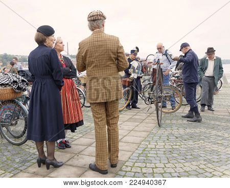 STOCKHOLM - SEPT 24, 2016: Many people in old fashioned clothes with bikes in the Bike in Tweed event September 24, 2016 in Stockholm, Sweden