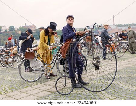 STOCKHOLM - SEPT 23, 2017: High wheeler or penny-farthing bicycle and people dressed in old fashioned tweed clothes in the Bike in Tweed event September 23, 2017 in Stockholm, Sweden