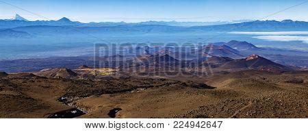 Stunning colored panorama volcano landscape of Kamchatka Peninsula - volcanic cones and lava plain, lifeless volcanic desert of fissure eruptions Tolbachik Volcano in Klyuchevskaya Group of Volcanoes.