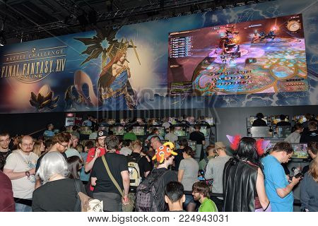 Cologne, Germany - August 24, 2017: Trade fair visitors waiting and playing the game final fantasy 14 at Gamescom 2017. Gamescom is a trade fair for video games held annually in Cologne.