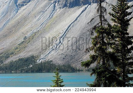 The Icefields Parkway between Banff, Canada and Jasper contains some of the most beautiful views in the world.  This is just one example of a mountain and a turquoise, glacier fed lake.