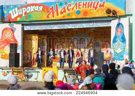TAGANROG, RUSSIA, 26 FEBRUARY 2017: Maslenitsa celebration. Choir of the city ensemble performs on stage in the city park
