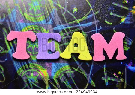 word team on an  abstract colored background