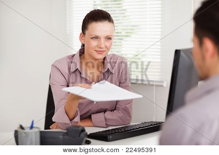 Businesswoman Presenting A Contract