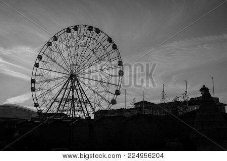 A Ferris wheel with lots of booths in the amusement Park of Sochi on the background of sky. Sochi. Russia. January 7, 2018.