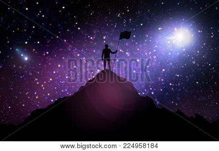 business, success, achievement and people concept - silhouette of businessman with flag on mountain top over space and starry sky background