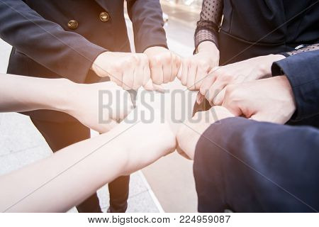Join forces and succesful team concept, businessman joining hand together