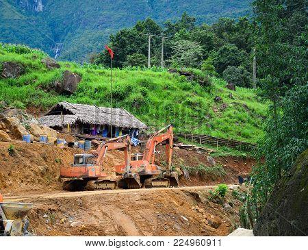 Sa Pa, Vietnam - May 31, 2016. Excavators Working On Road Construction In Sa Pa, Vietnam. Sa Pa Is A