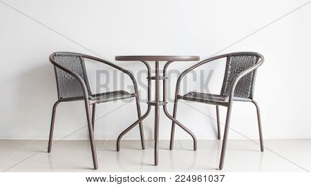 brown rattan chairs inside white wall in hotel room