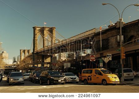 NEW YORK CITY - APR 1: Downtown Manhattan street view with Brooklyn Bridge on April 1, 2015 in Manhattan, New York City. With population of 8.4M, it is the most populous city in the United States.