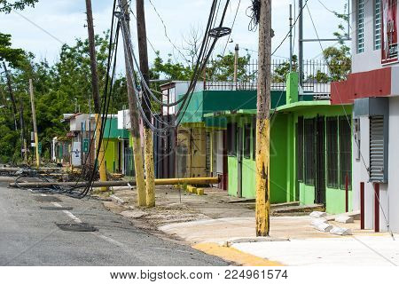 Roadside scene in Rincon, Puerto Rico after Hurricane Marie showing damage to businesses and power lines