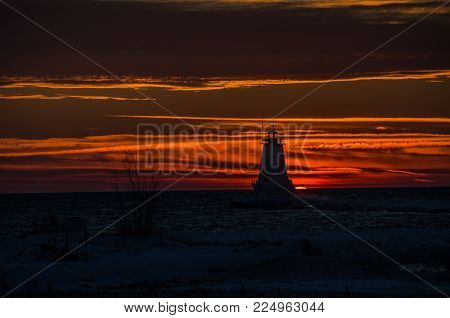 Silhouette of Ludington, Michigan's, North Breakwater Light at sunset