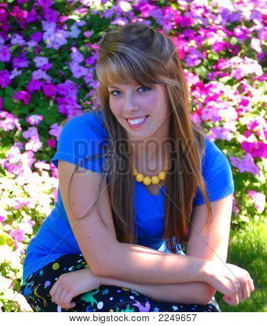 Pretty Teenage Girl Crouched Down