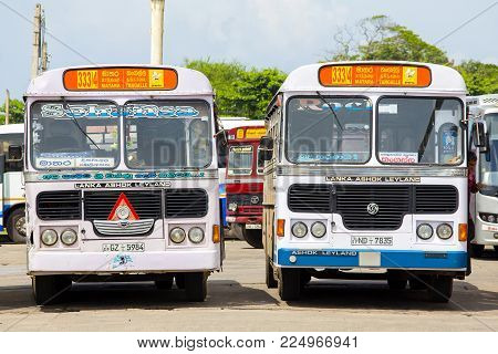 MATARA, SRI LANKA - NOVEMBER 5, 2014: Regular public bus from Matara to Tangalle. Buses are the most widespread public transport type in Sri Lanka.
