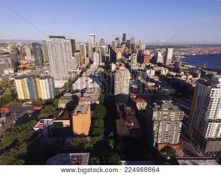Mount Rainier Can Be Seen 75 Miles Away From The Buildings And Piers Of Seattle