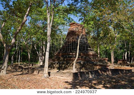 Ruins of the ancient Buddhist temple in the jungle. Neighborhood of the city of the Sukhothai, Thailand