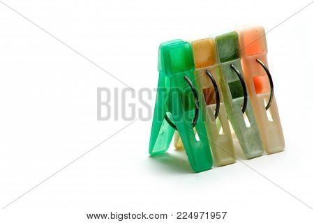 Sets color clothes-pegs over white background, isolated