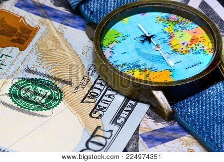 Watch with global map on cash money. World map clock. Worldwide business concept. Cash banknotes background. Global business. Worldwide business travel. Emerging market profit. Economy globalisation